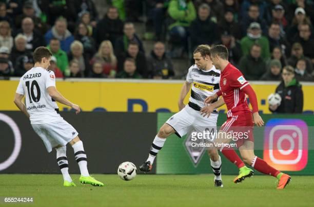 Tony Jantschke and Thorgan Hazard of Borussia Moenchengladbach are chased by Robert Lewandowski of FC Bayern Muenchen during the Bundesliga Match...