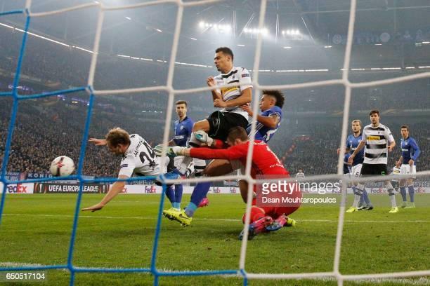 Tony Jantschke and Timotheee Kolodziejczak of Borussia Moenchengladbach battle with Ralf Faehrmann and Thilo Kehrer of Schalke during the UEFA Europa...
