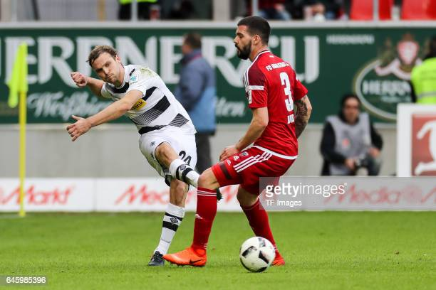 Tony Jantschke of Borussia Moenchengladbach and Anthony Jung of Ingolstadt battle for the ball during the Bundesliga match between FC Ingolstadt 04...