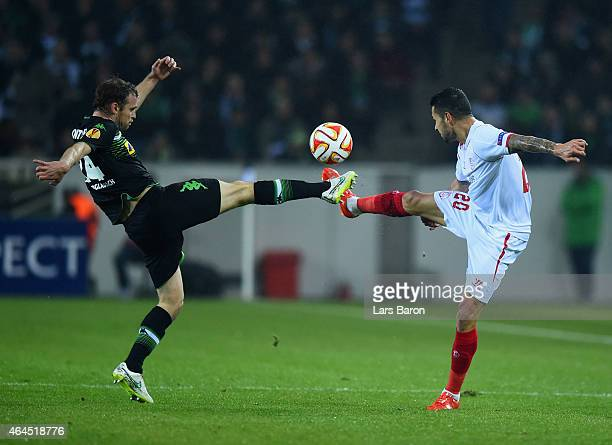 Tony Jantschke of Borussia Moenchengladbach and Vitolo of Sevilla battle for the ball during the UEFA Europa League Round of 32 second leg match...