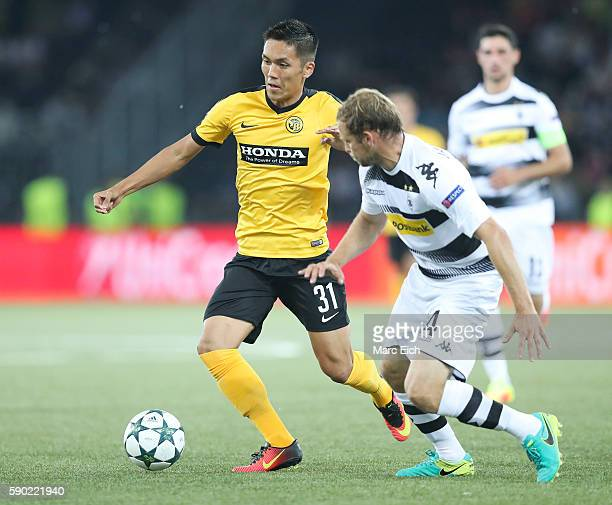Tony Jantschke of Borussia Moenchengladbach challenges Yuya Kubo of Young Boys Bern during the Champions League Playoff match between Young Boys Bern...