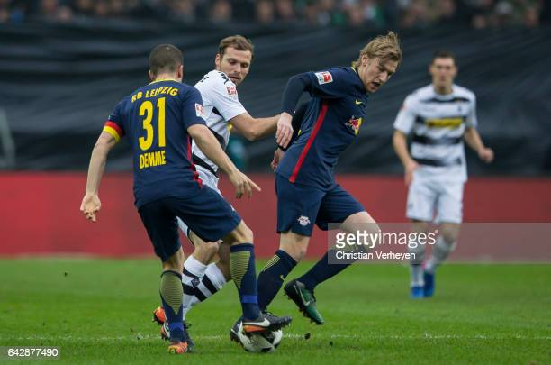 Tony Jantschke of Borussia Moenchengladbach Diego Demme and Emil Forsberg of RB Leipzig battle for the ball during the Bundesliga Match between...