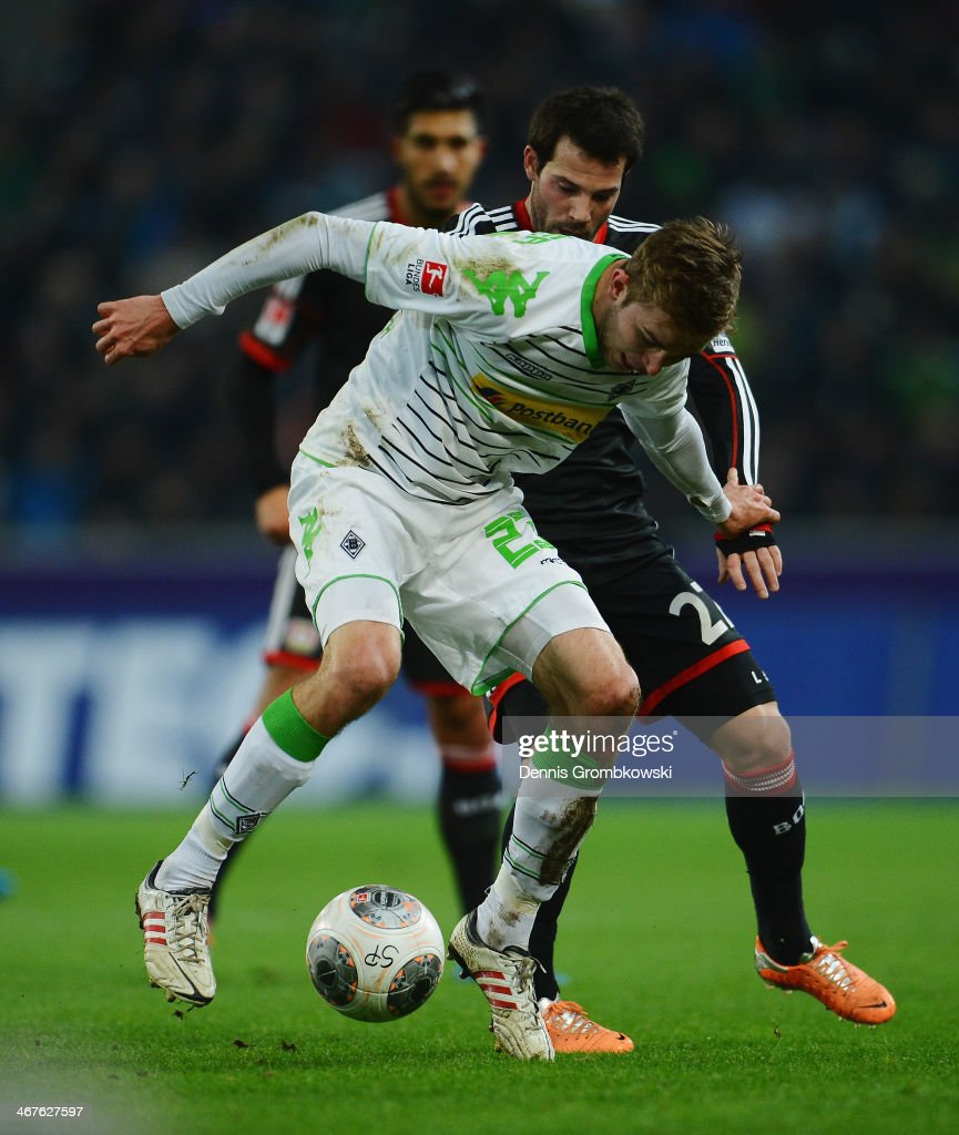 <a gi-track='captionPersonalityLinkClicked' href=/galleries/search?phrase=Tony+Jantschke&family=editorial&specificpeople=4158344 ng-click='$event.stopPropagation()'>Tony Jantschke</a> of Borussia Moenchengladbach is challenged by <a gi-track='captionPersonalityLinkClicked' href=/galleries/search?phrase=Gonzalo+Castro&family=editorial&specificpeople=605388 ng-click='$event.stopPropagation()'>Gonzalo Castro</a> of Bayer Leverkusen during the Bundesliga match between Borussia Moenchengladbach and Bayer Leverkusen at Borussia-Park on February 7, 2014 in Moenchengladbach, Germany.