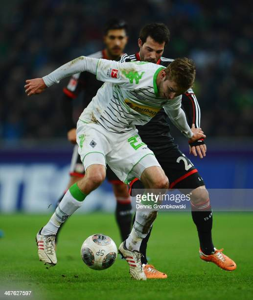 Tony Jantschke of Borussia Moenchengladbach is challenged by Gonzalo Castro of Bayer Leverkusen during the Bundesliga match between Borussia...