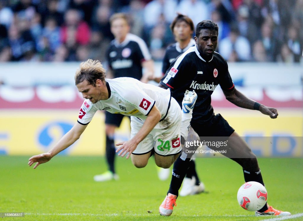 Tony Jantschke of Moenchengladbach challenged by Olivier Occean of Frankfurt during the Bundesliga match between VfL Borussia Moenchengladbach and Eintracht Frankfurt at Borussia Park Stadium on October 7, 2012 in Moenchengladbach, Germany.