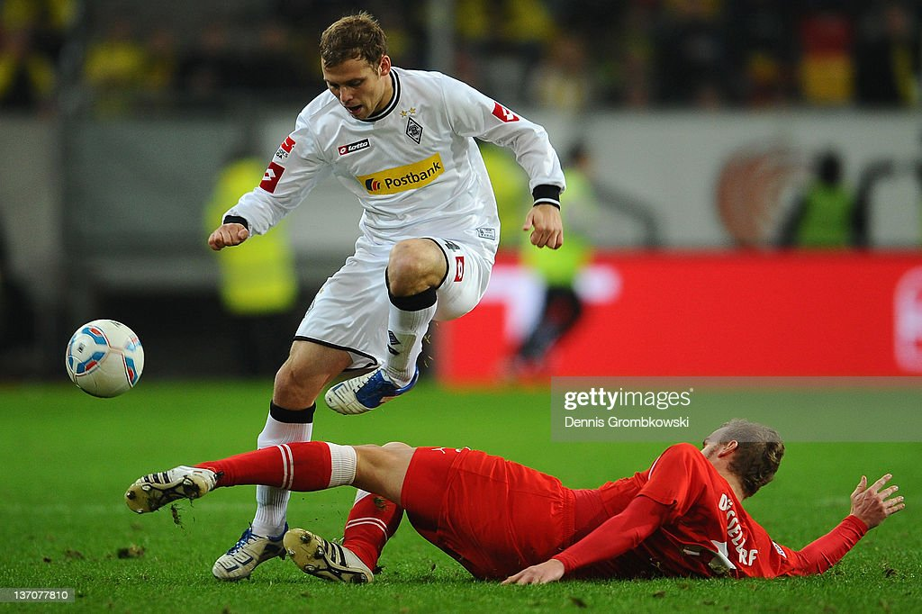 Tony Jantschke (L) of Moenchengladbach is challenged by <a gi-track='captionPersonalityLinkClicked' href=/galleries/search?phrase=Sascha+Dum&family=editorial&specificpeople=673734 ng-click='$event.stopPropagation()'>Sascha Dum</a> (R) of Duesseldorf during the Stadtwerke Duesseldorf Wintercup 2012 final between Fortuna Duesseldorf and Borussia Moenchengladbach at Esprit-Arena on January 15, 2012 in Duesseldorf, Germany.