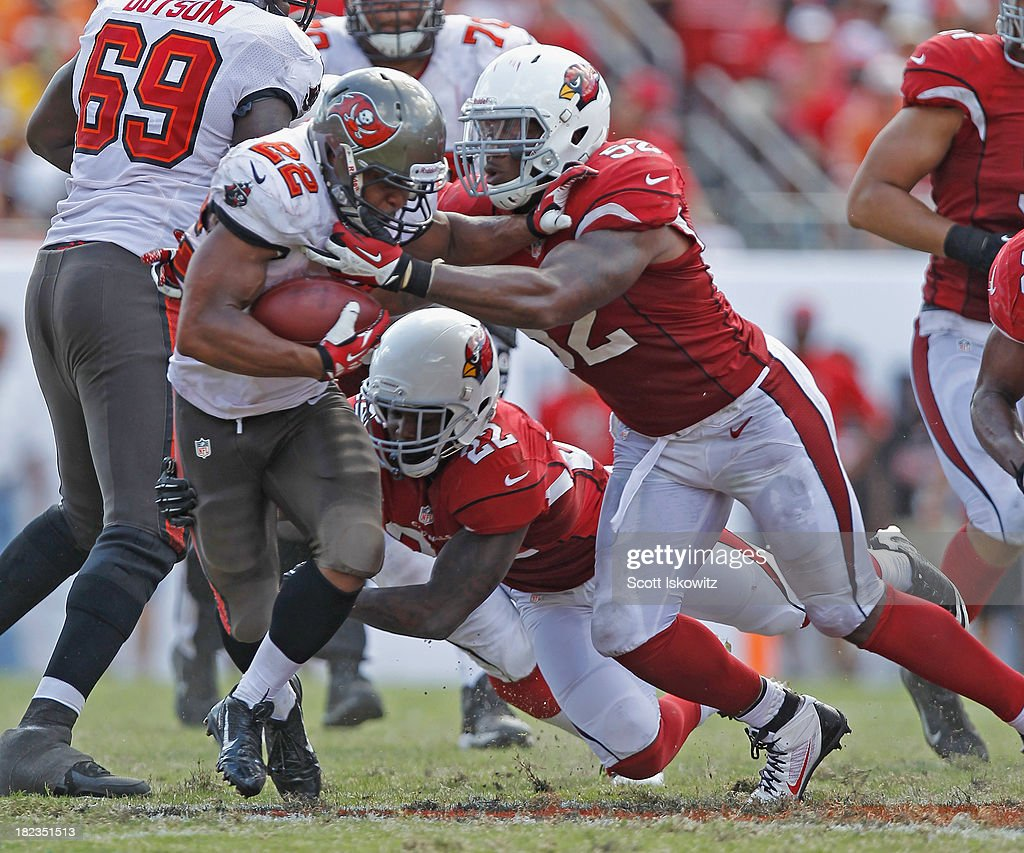 Tony Jefferson #22 and <a gi-track='captionPersonalityLinkClicked' href=/galleries/search?phrase=Jasper+Brinkley&family=editorial&specificpeople=4032417 ng-click='$event.stopPropagation()'>Jasper Brinkley</a> #52 of the Arizona Cardinals tackle <a gi-track='captionPersonalityLinkClicked' href=/galleries/search?phrase=Doug+Martin+-+American+Football+Running+Back&family=editorial&specificpeople=9693143 ng-click='$event.stopPropagation()'>Doug Martin</a> #22 of the Tampa Bay Buccaners at Raymond James Stadium on September 29, 2013 in Tampa, Florida.