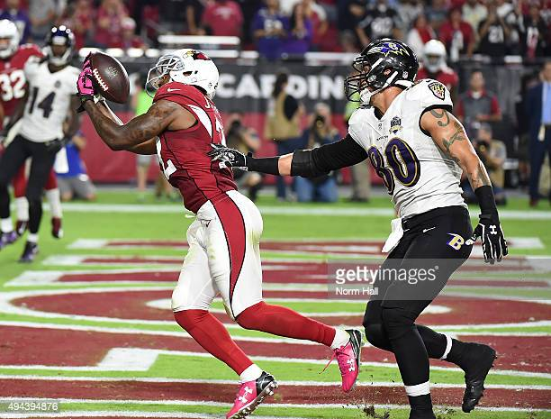 Tony Jefferson of the Arizona Cardinals intercepts a pass in the final seconds of a game against the Baltimore Ravens at University of Phoenix...