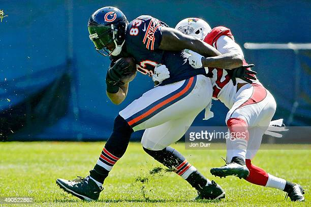 Tony Jefferson of the Arizona Cardinals tackles Martellus Bennett of the Chicago Bears during the first half at Soldier Field on September 20 2015 in...