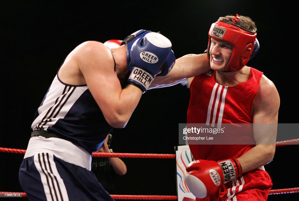 Tony Jeffries of England attacks Imre Szello of Hungary during the Amateur Boxing Association England v Hungary Tournament at the Newham Leisure...