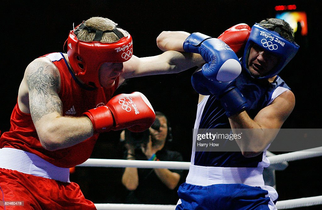 Tony Jeffries of Great Britain competes against Imre Szello of Hungary during the 81kg quarterfinal boxing event at the Workers' Indoor Arena on Day...