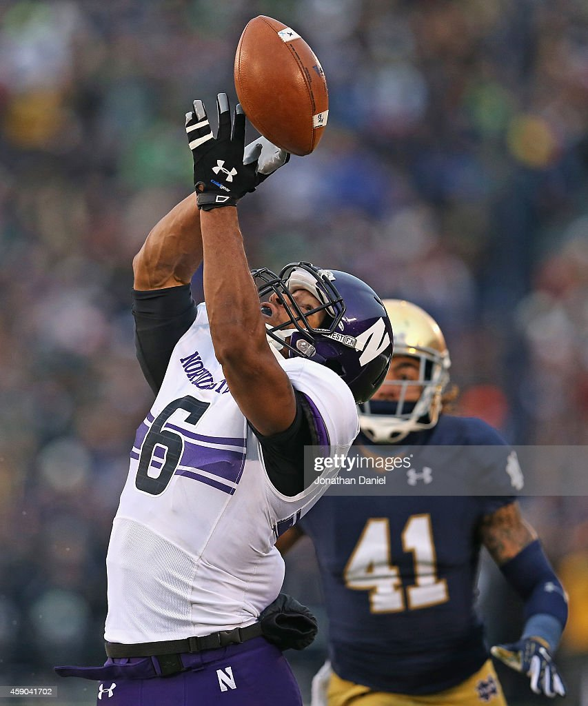 Tony Jones of the Northwestern Wildcats can't handle a pass in front of Matthias Farley of the Notre Dame Fighting Irish at Notre Dame Stadium on...