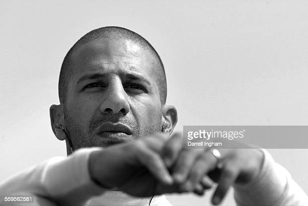 Tony Kanaan driver of the Andretti Green Racing Team 7Eleven Honda Dallara during practice for the Indy Racing League IndyCar Series Michigan Indy...