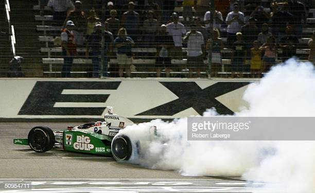 Tony Kanaan driver of the Team 7Eleven Andretti Green Racing Honda Dallara does donuts on the front stretch after winning the Indy Racing League...