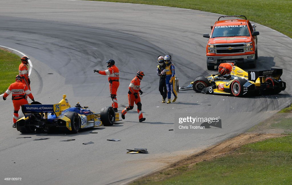 <a gi-track='captionPersonalityLinkClicked' href=/galleries/search?phrase=Tony+Kanaan&family=editorial&specificpeople=171962 ng-click='$event.stopPropagation()'>Tony Kanaan</a> of Brazil driver of the #10 Glad Target Chip Ganassi Racing Dallara Chevrolet and <a gi-track='captionPersonalityLinkClicked' href=/galleries/search?phrase=Marco+Andretti&family=editorial&specificpeople=540446 ng-click='$event.stopPropagation()'>Marco Andretti</a> driver of the #25 Andretti Autosport Chevrolet are involved in an incident on the first lap of the Verizon IndyCar Series Honda Indy 200 at Mid-Ohio Sports Car Course on August 3, 2014 in Lexington, Ohio.