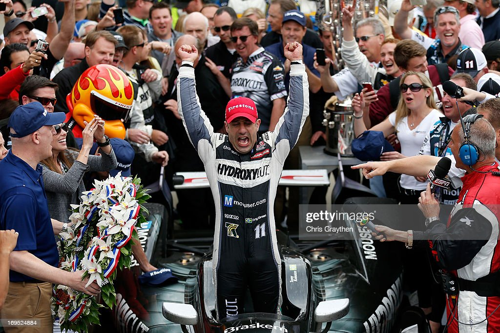 Tony Kanaan of Brazil, driver of the Hydroxycut KV Racing Technology-SH Racing Chevrolet, celebrates in victory lane after he won the IZOD IndyCar Series 97th running of the Indianpolis 500 mile race at the Indianapolis Motor Speedway on May 26, 2013 in Indianapolis, Indiana.