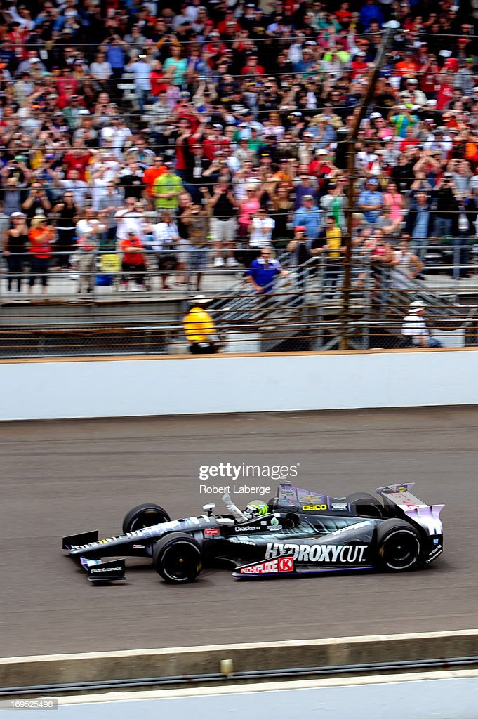 <a gi-track='captionPersonalityLinkClicked' href=/galleries/search?phrase=Tony+Kanaan&family=editorial&specificpeople=171962 ng-click='$event.stopPropagation()'>Tony Kanaan</a> of Brazil, driver of the Hydroxycut KV Racing Technology-SH Racing Chevrolet, celebrates as he races towards the start/finish line to take the checkered flag and win the IZOD IndyCar Series 97th running of the Indianpolis 500 mile race at the Indianapolis Motor Speedway on May 26, 2013 in Indianapolis, Indiana.