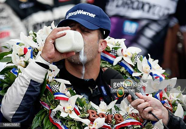 Tony Kanaan of Brazil driver of the Hydroxycut KV Racing TechnologySH Racing Chevrolet takes a sip of milk in victory lane as he celebrates winning...