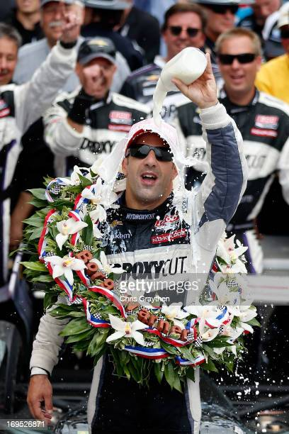 Tony Kanaan of Brazil driver of the Hydroxycut KV Racing TechnologySH Racing Chevrolet pours the victory milk over his head as he celebrates in...
