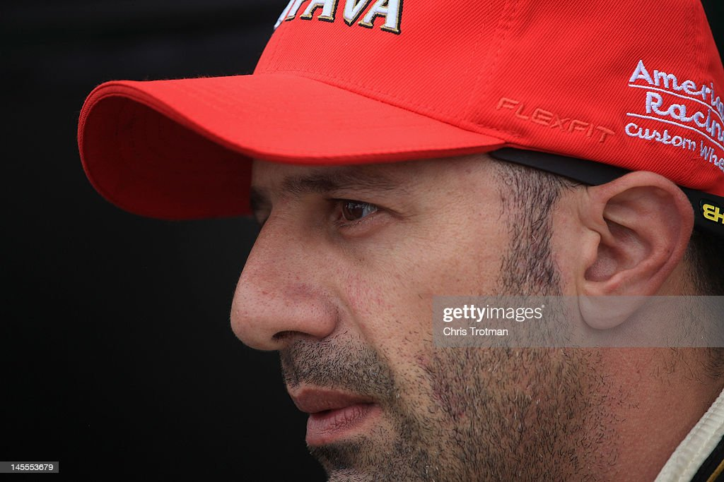 <a gi-track='captionPersonalityLinkClicked' href=/galleries/search?phrase=Tony+Kanaan&family=editorial&specificpeople=171962 ng-click='$event.stopPropagation()'>Tony Kanaan</a> of Brazil, driver of the #11 KV Racing Technolgy sits in the pits during practice for the IZOD INDYCAR Series Chevrolet Detroit Belle Isle Grand Prix on Belle Isle on June 1, 2012 in Detroit, Michigan.