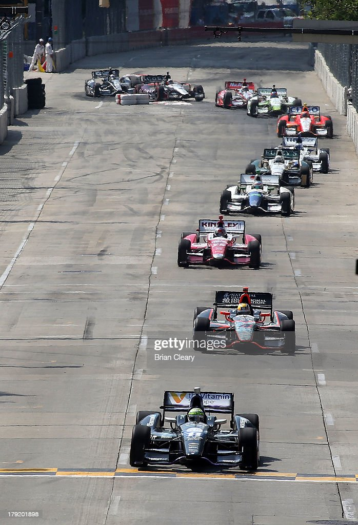 <a gi-track='captionPersonalityLinkClicked' href=/galleries/search?phrase=Tony+Kanaan&family=editorial&specificpeople=171962 ng-click='$event.stopPropagation()'>Tony Kanaan</a>, of Brazil, driver of the #11 KV Racing Technology Chevrolet Dallara drives over the starting line to start his record 212th consecutive Indy Car race during the Grand Prix of Baltimore on September 1, 2013 in Baltimore, Maryland.