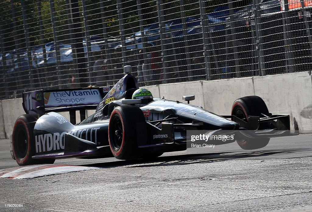 Tony Kanaan, of Brazil, driver of the #11 KV Racing Technology Chevrolet Dallara drives through a turn during his record 212th consecutive Indy Car race during the Grand Prix of Baltimore on September 1, 2013 in Baltimore, Maryland.