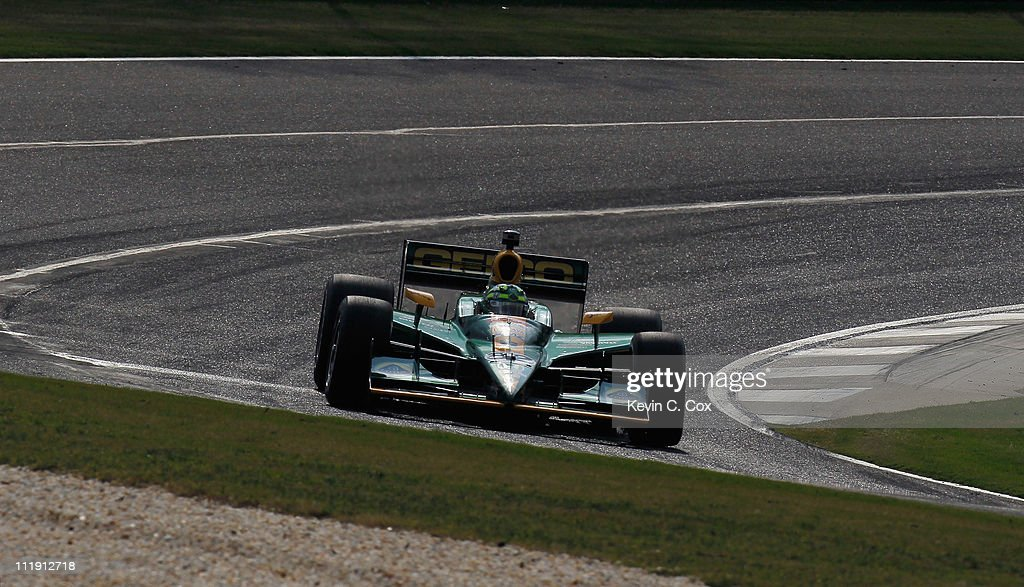 Tony Kanaan of Brazil driver of the KV Racing TechnologyLotus Dallara Honda drives during practice for the IndyCar Series Honda Indy Grand Prix of...