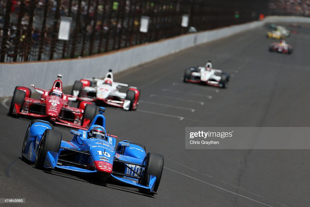 <a gi-track='captionPersonalityLinkClicked' href=/galleries/search?phrase=Tony+Kanaan&family=editorial&specificpeople=171962 ng-click='$event.stopPropagation()'>Tony Kanaan</a> of Brazil driver of the #10 NTT Data Chip Ganassi Racing Chevrolet Dallara leads a pack of cars during the 99th running of the Indianapolis 500 mile race at Indianapolis Motorspeedway on May 24, 2015 in Indianapolis, Indiana.