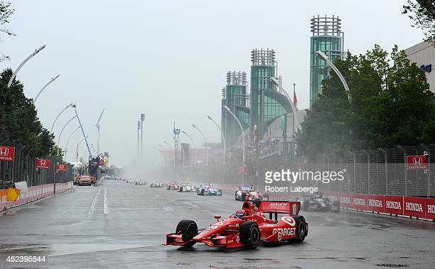 Tony Kanaan of Brazil driver of the Target Chip Ganassi Racing Dallara Chevrolet leads a pack of cars during parade laps of race 1 of the Verizon...