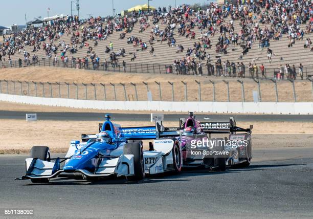 Tony Kanaan of BrazilChip Ganassi Racing gets a gentle push from behind by Mikhail Aleshin of RussiaSchmidt Peterson Motorsports during the Verizon...