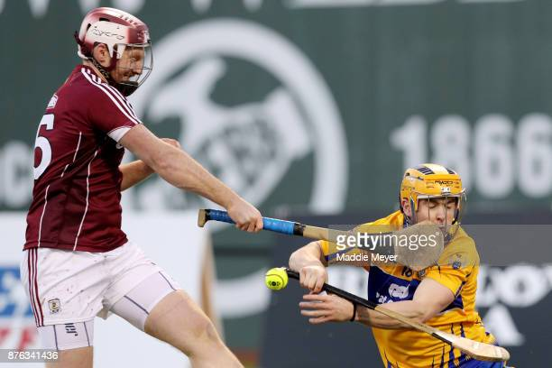 Tony Kelly of Clare is hit in the face by John Hanbury of Galway during the 2017 AIG Fenway Hurling Classic and Irish Festival at Fenway Park on...