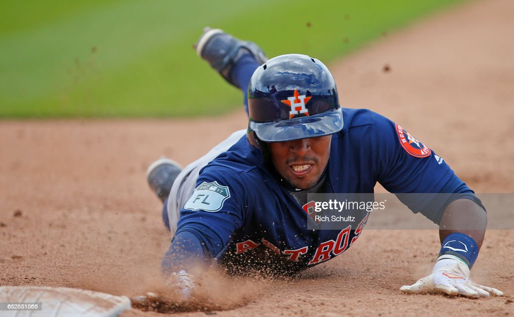 Tony Kemp #18 of the Houston Astros dives safely back into first base on a pickoff attempt in the fifth inning against the Washington Nationals during a spring training baseball game on March 12, 2017 in West Palm Beach, Florida.