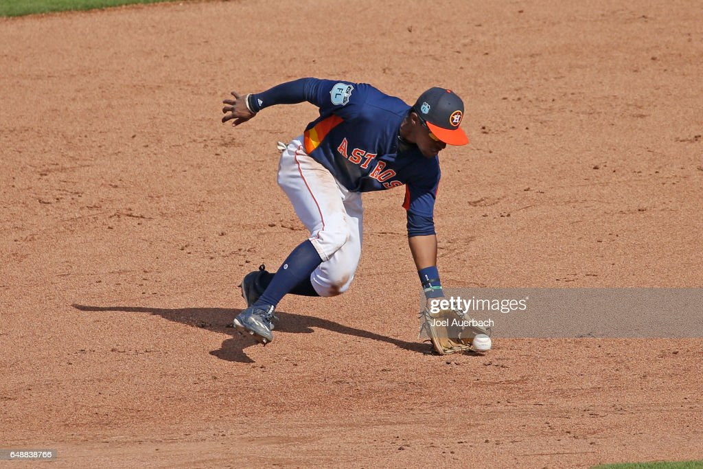 Tony Kemp #18 of the Houston Astros fields the ball hit by Brian Bogusevic #36 of the Boston Red Sox in the sixth inning during a spring training game at The Ballpark of the Palm Beaches on March 6, 2017 in West Palm Beach, Florida. The Astros and Red Sox played to a 5-5 tie.