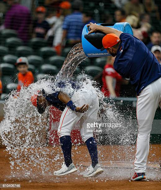 Tony Kemp of the Houston Astros is doused with water by Lance McCullers during a post game interview at Minute Maid Park on September 25 2016 in...