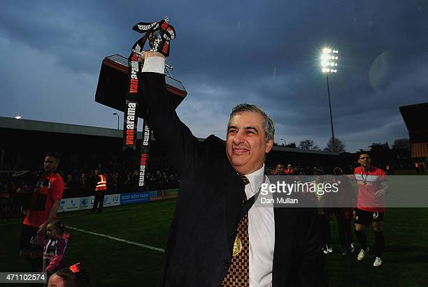 Tony Kleanthous Chairman of Barnet celebrates with the trophy after his side win promotion during the Vanarama Football Conference League match...