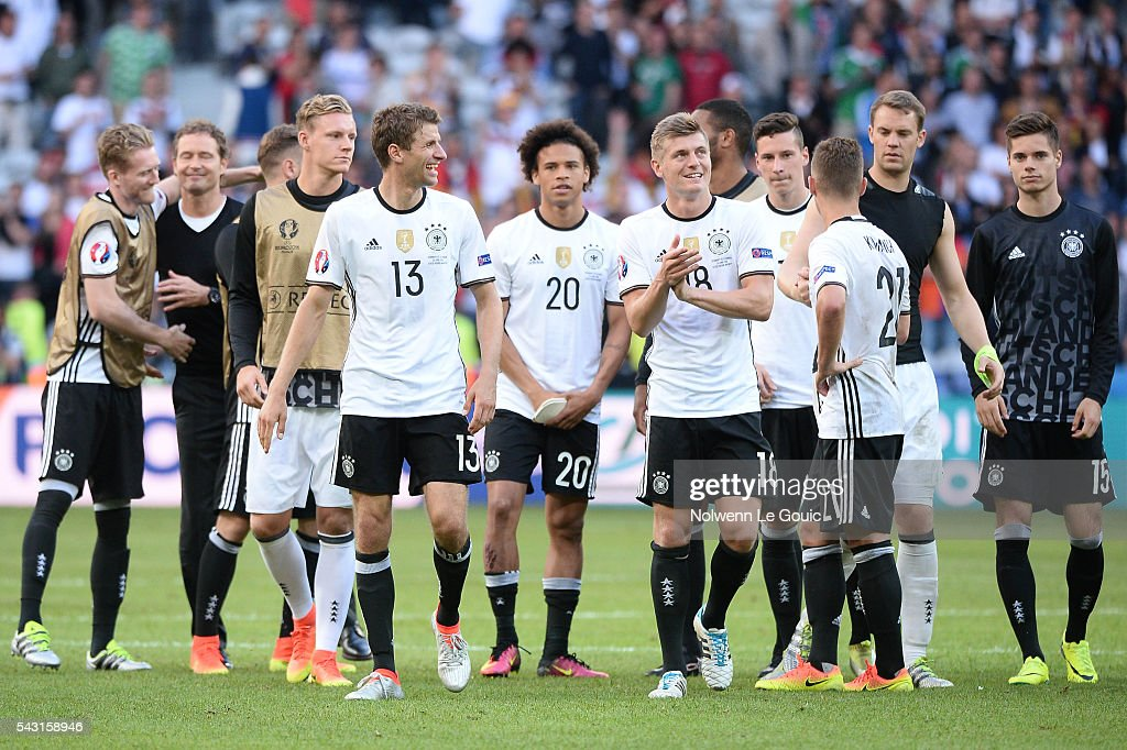 Tony Kroos of Germany and Thomas Muller of Germany celebrate victory during the European Championship match Round of 16 between Germany and Slovakia at Stade Pierre-Mauroy on June 26, 2016 in Lille, France.