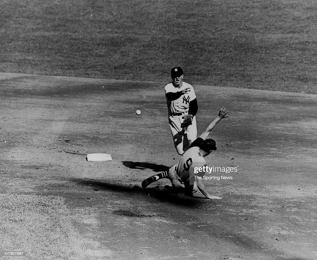 Tony Kubek of the New York Yankees turns a double play over Bill Mazeroski of the Pittsburgh Pirates in Game Five of the 1960 World Series October 10, 1960 at Yankee Stadium in the Bronx borough of New York City..