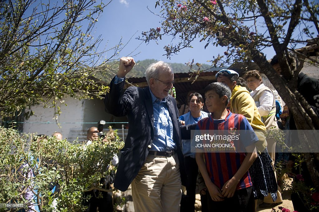 Tony Lake Executive Director of the United Nations Children's Fund speaks with a boy during a visit to the Paqui village Totonicapan departament 200...