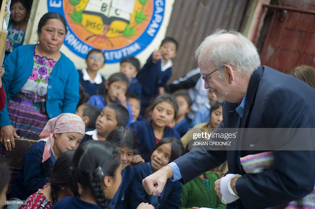Tony Lake Executive Director of the United Nations Children's Fund plays with children during a visit to the Paqui village Totonicapan departament...