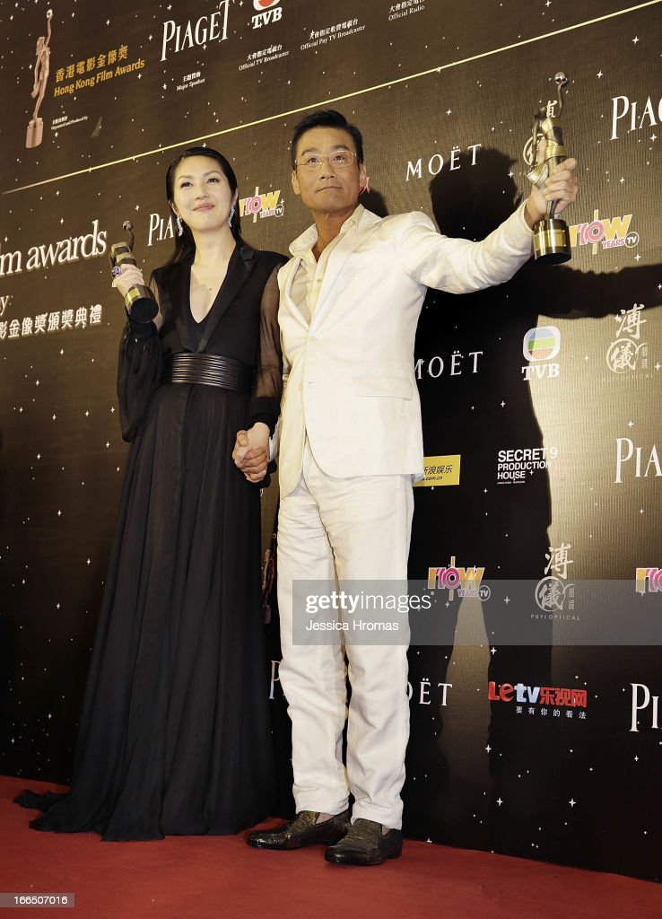Tony Leung Ka Fai (R), winner of the award for Best Actor, and Miriam Yeung, winner of the award for Best Actress pose with their awards in the Awards room at the 2013 Hong Kong Film Awards on April 13, 2013 in Hong Kong, Hong Kong.
