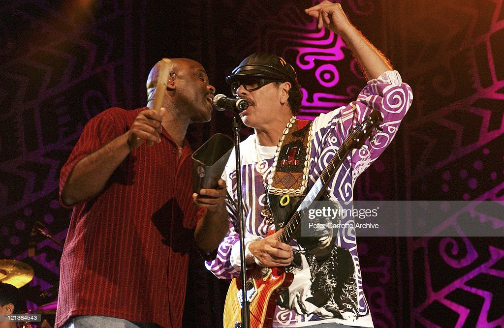 <a gi-track='captionPersonalityLinkClicked' href=/galleries/search?phrase=Tony+Lindsay&family=editorial&specificpeople=3435613 ng-click='$event.stopPropagation()'>Tony Lindsay</a> and Carlos Santana performing on stage during his 'Shaman' concert tour at Centennial Park on March 27, 2003 in Sydney, Australia.