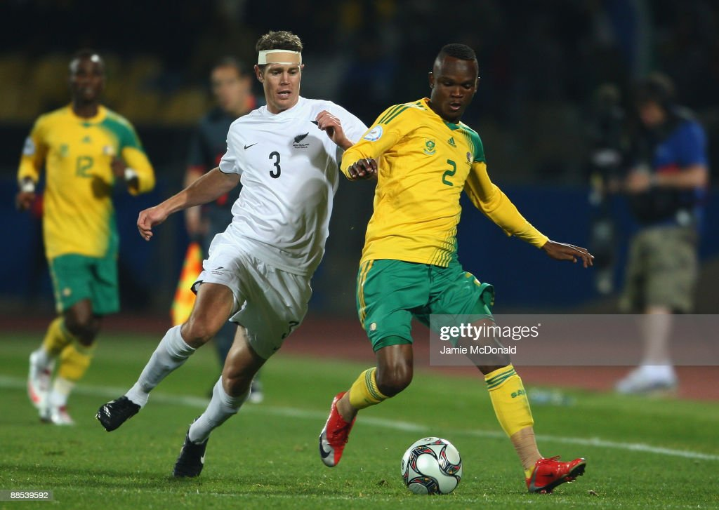 Tony Lochhead of New Zealand battles with Siboniso Gaxa of South Africa during the FIFA Confederations Cup match between South Africa and New Zealand...