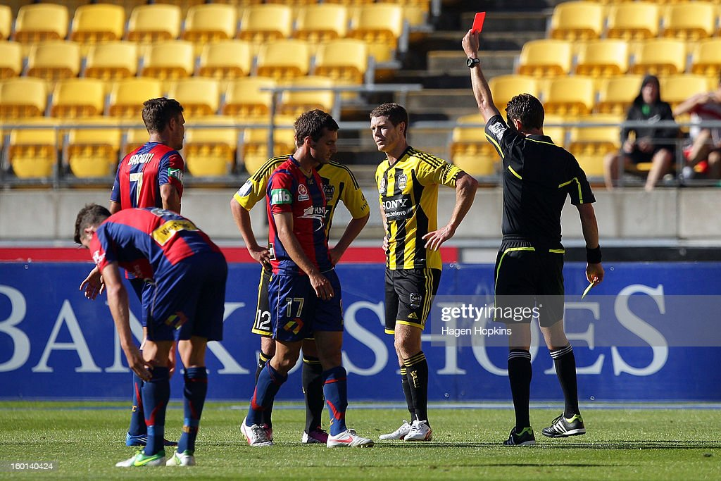 Tony Lochhead of the Phoenix is shown a red card by referee Ben Williams during the round 18 A-League match between the Wellington Phoenix and the Newcastle Jets at Westpac Stadium on January 27, 2013 in Wellington, New Zealand.