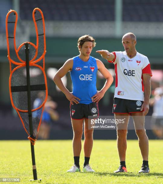 Tony Lockett coaches Oliver Florent of the Swans during a Sydney Swans AFL training session at Sydney Cricket Ground on May 10 2017 in Sydney...