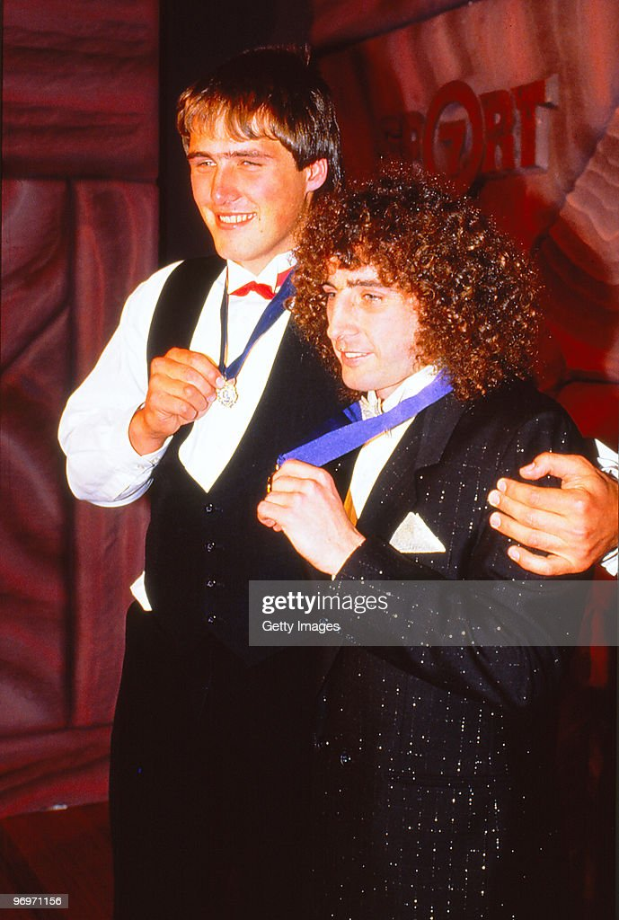 Tony Lockett of St Kilda and John Platten of the Hawthorn Hawks pose with the 1987 Browlow Medal in Melbourne, Australia.