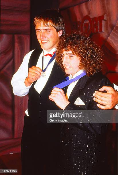 Tony Lockett of St Kilda and John Platten of the Hawthorn Hawks pose with the 1987 Browlow Medal in Melbourne Australia