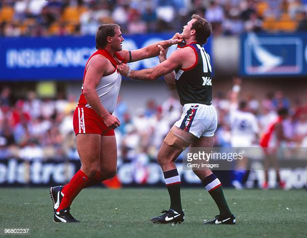 Tony Lockett of the Swans fights with a Fremantle Dockers defender during an AFL match at the SCG in Sydney Australia