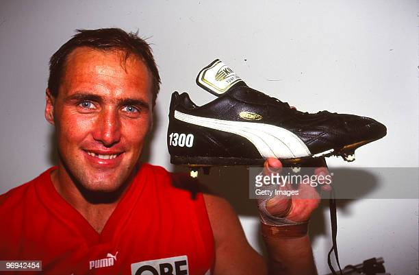 Tony Lockett of the Swans hold his boot used to kick his 1300th AFL goal following the round ten match between Sydney Swans and Collingwood Magpies...