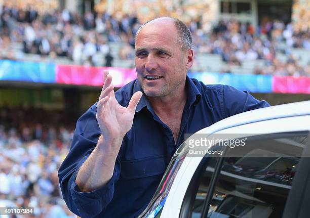 Tony Lockett waves to the crowd as he takes part in the Retiring Players Motorcade during the 2015 AFL Grand Final match between the Hawthorn Hawks...