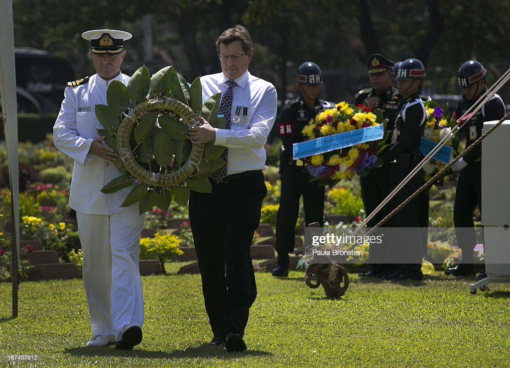 Tony Lynch, New Zealand Ambassador to Thailand (right) prepares to lay a wreath during the Wreath Laying Ceremony at the Kanchanaburi War Cemetery April 25, 2013 in Kanchanaburi, Thailand. Hellfire Pass is a small section of the Burma-Thailand railway which was built by POW's and Asian Laborers under horrific conditions during the Second World War (WWII). Heavy loss of life was suffered during construction due to disease, starvation and exhaustion.
